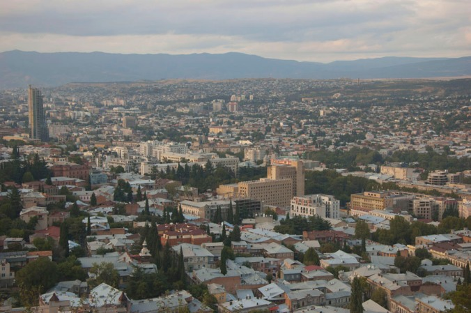 Panorama View via Tbilisi in the north direction over a houses till the horizon during sunset